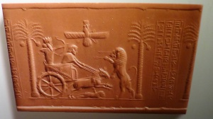 Roayl seal of darius the Great 522-486 BCE showing the King in his chariot facing a lion