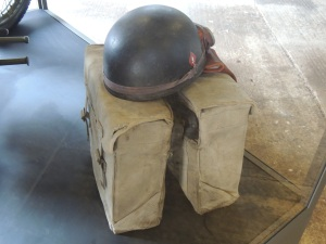 A disptach riders helmet and panniers