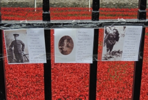 People have added their own personal memorials to the railings surrounding the moat