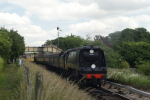 34007 Wadebridge departs Ropley Station. Photo by Peter Trimming [CC BY-SA 2.0 (http://creativecommons.org/licenses/by-sa/2.0)], via Wikimedia Commons