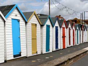 """Beach Huts, Marine Drive - geograph.org.uk - 1772035"" by David Dixon. Licensed under CC BY-SA 2.0 via Wikimedia Commons - http://commons.wikimedia.org/wiki/File:Beach_Huts,_Marine_Drive_-_geograph.org.uk_-_1772035.jpg#/media/File:Beach_Huts,_Marine_Drive_-_geograph.org.uk_-_1772035.jpg"
