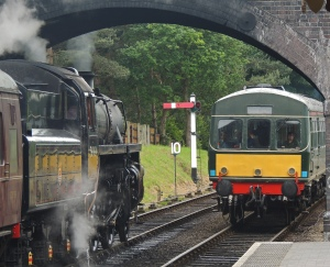 76084 leaqves Weybourne bound for Holt as DMU enters station bound for Sheringham