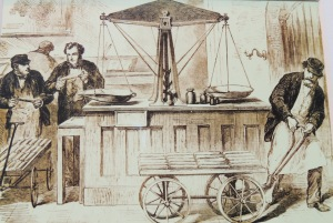Gold being weighed before being deposited